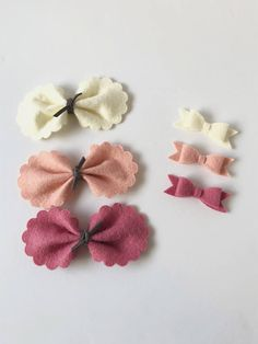 Adorable felt bow set comes with 3 bows in cream, blush, and rose. Is the perfect Valentine bow set for your little sweetheart. ** Just choose your style and dont forget we have pigtail sets for the mini chunky, mini twist, and the classic mini.** Bows come attached to your choice