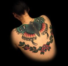 Stunning butterfly back tattoo by artist Myra Brodsky.