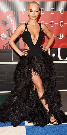 The Best and the Boldest Looks of the Night | RITA ORA | Never one to skimp on the drama (just the fabric), the singer stayed in tune with her style M.O. in a custom Vera Wang gown, complete with an ostrich feather skirt, and Stuart Weitzman sandals.