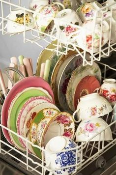 dishwasher full of vintage floral dishes.