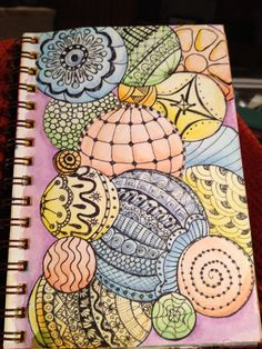 Zentangle in art journal: pen and watercolor pencils, by Claire.