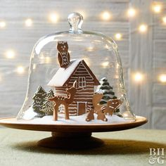 4 Clever Ways to Turn Gingerbread Cookies into a Woodland Wonderland Gingerbread Cutouts on wooden pedestal stand with glass cover and christmas lights Best Gingerbread Cookies, Gingerbread Christmas Decor, Christmas Sweets, Noel Christmas, Christmas Goodies, Christmas Baking, Gingerbread Houses, Winter Torte, Hanging Christmas Lights