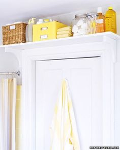 Make space for supplies over the bathroom door so that they'll be accessible when they need to be replenished. Use wood screws to secure a pair of wooden shelf brackets to either side of the door frame; screw shelf to brackets. The shelf should rest on top of the door molding, which will help support the weight. Keep small bottled items and toilet paper in handled boxes. Bars of soap can be stored, unwrapped, in an airtight glass container. Small Space Storage, Small Bathroom Storage, Bathroom Organization, Storage Spaces, Extra Storage, Storage Ideas, Small Bathrooms, Storage Solutions, Smart Storage