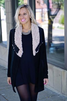 Long sleeve black cardigan with faux fur trim and pockets.