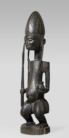 A Bamana Gwandiki sculpture - the male pendant of the more well known Gwandusu Figures.