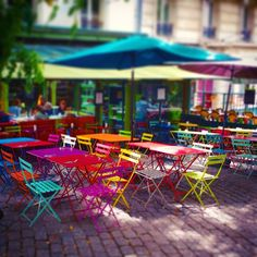 With the colorful chairs the L'Eté en Pente Douce is the perfect bistro for Instagram. #France #Paris #bistro #café #restaurant #chairs #seating #colorful #happy #rainbow #travel #instatravel #instaparis #streetphotograhy #pfw #pfw16 #parisfashionweek #exterior #restaurantdesign