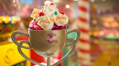A plastic trophy cup of ice cream topped with whipped cream, gummy bears, cherries and Comida Disney, Disney Food, Disney Dream Cruise, Vanellope, Ice Cream Toppings, Wreck It Ralph, No Bake Treats, Gummy Bears, Treat Yourself