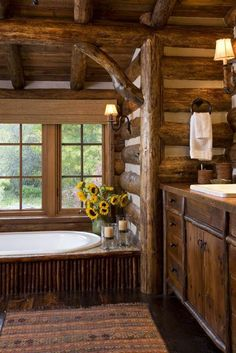 Love this rustic bathroom with great mountain views!