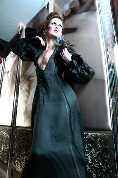 Double layered sik gown with Swarovski embroidery - Sample size - 397Euros  Silk black bolero with feather details and Swarovskis - Sample size - 138EUros