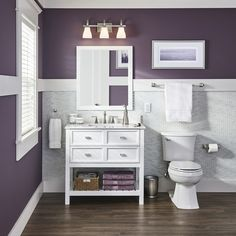 Get a fresh look in your bathroom with a new vanity designed by Drew and Jonathan Scott of the Property Brothers. An open shelf provides convenient access to towels, and pullout drawers neatly store toiletries.