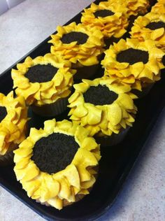 Sunflower Cupcakes!  Super easy, all you need is an oreo and something to make the petals with the frosting!