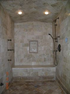 shower tile images   Antiqued marble steam shower with diagonal pitched shower ceiling