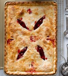 If you love pies with a higher fruit filling to crust ratio then this cherry slab pie is for you. You can use either fresh or frozen cherries in this recipe. Cherry Recipes, Pie Recipes, Cooking Recipes, Cherry Slab Pie Recipe, Nutella Recipes, Crowd Recipes, Pastries Recipes, Fruit Recipes, Yummy Recipes