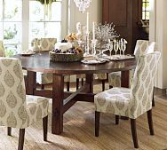 I love a round table. I wouldn't go with the print on these chairs, though. I'd do a neutral solid to showcase the table.