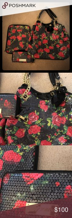 Betsey Johnson floral 3 piece set -black &red rose Excellent mint condition !!! I only used the purse a few times. Thewallet Gold plate has a few tiny scratches from being in the purse. Never used the iPad case. The iPad case can be used as an organizer as well. Has 1 large pocket and small card holder pocket for 3 cards .wallet is expandable with lots of pockets. Getting rid of some non- essentials to get ready for the baby! :) Comes with all 3 pieces: purse, expandable wallet, iPad holder…