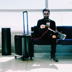 """The Bluesmart. Billed as the """"World's First Smart Connected Luggage,"""" the new Black Edition is a sleek, durable soft/hard hybrid carry-on suitcase with an app-enabled location tracker, remote locking capabilities and a built-in battery charger and digital scale. Click to find out more!"""