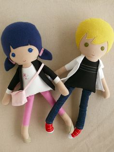 **Custom listing for Melissa:**  These are handmade cloth dolls measuring 20 inches. The blond haired boy is wearing a white over-shirt, black t-shirt, dark denim jeans, and red sneakers. The blue-haired girl wears and black jacket over and embroidered shirt, pink cropped pants, tan shoes, and a pink purse. They are made from 100% cotton fabrics, no-pill fleece, wool blend felt, and polyester fiberfill. Their seams are triple stitched, and they are firmly stuffed with fiberfill.  Please hand…