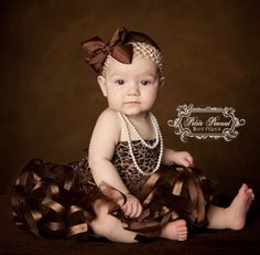 Cute idea for a photo shoot with a baby.  Love the chocolate brown.