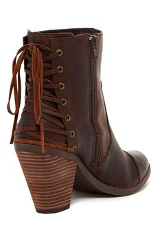 "Peru Corset Boot ; Adam Tucker for Me Too  $131 - $45 @HauteLook. [back] - Round cap toe - Paneled construction - Side zip closure - Lace-up back detail - Chunky stacked heel - Approx. 6"" shaft height, 10.5"" opening circumference - Approx. 3.5"" heel - Leather upper, manmade sole"