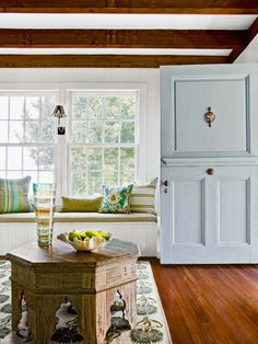 pale blue front door + built in window seat