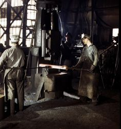 Working with a small steam drop hammer at the blacksmith shop in the Santa Fe R.R. shops, Topeka, Kansas, March 1943.  Photo by Jack Delano. LOC