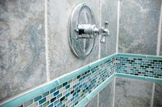 sumi-e mini brick hokkaido natural with small cayman blue silk liner bar used in the bathroom surround