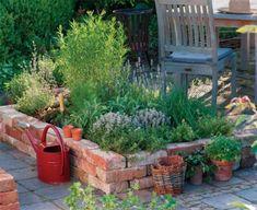 What a beautiful and stylish raised garden bed using old bricks. A simple DIY garden! Building A Raised Garden, Raised Garden Beds, Raised Beds, Brick Garden, Garden Paths, Herb Garden, Vegetable Garden, Old Bricks, Garden Cottage