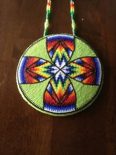 Native Beaded medallion by Lennis Denny