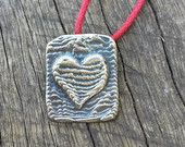 HEART and RECTANGLE PENDANT, sterling silver cast into carved cuttlefish bone, lovely natural texture. Each piece is unique!