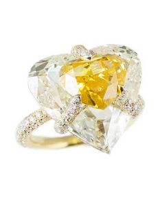 This Boghossian Jewels engagement ring from the Kissing Diamonds collection is set with a Fancy Vivid orangey yellow diamond.