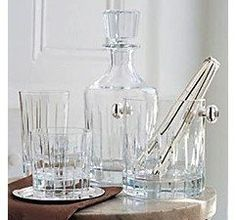 Christofle Iriana - Typical for the collection Iriana are the vertical cut lines. Also available are whisky tumbler, hiball glasses, vodka glasses, a carafe, an ice bucket and wine and champagne glasses.   The french silver manufactory Christofle is well-known for silver flatware and accessories. Glasses made of crystal glass complete the knowhow of the silversmith. SHOP NOW https://boulesse.com/en/product/5325/Christofle/Iriana-Whisky-carafe