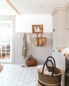 Our Traditional Farmhouse Laundry and Mud Room - The Wild Decoelis Laundry and mudroom with grey wood panelling, shaker peg, hexagon white tiles, vintage prints farmhouse traditional House, Laundry Mud Room, Interior, Home, Farmhouse Laundry Room, Room Renovation, Home Remodeling, Cheap Home Decor, House Interior