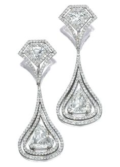 PAIR OF DIAMOND PENDENT EARRINGS.  Each surmount set with a fancy-shaped rose-cut diamond bordered by two lines of brilliant-cut stones, suspending a similarly set pear-shaped rose-cut diamond, mounted in white gold.