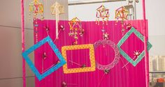 Dream Craft Events beautifully executed this decoration for an outdoor mehendi setup.| weddingz.in | India's Largest Wedding Company | Wedding Venues, Vendors and Inspiration | Indian Mehendi Ceremony Photobooth Decoration Ideas  |
