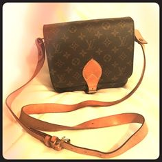 """Louis Vuitton Monogram Cartouchiere MM LV bag Shoulder bag can be used as Crossbody                        This bag is authentic and used and has sign of wear, but still in very good condition. Size approx: L 8.27"""" x H 7.28"""" x W 2.75""""             Strap drop: 21.27"""" - 23.24""""  MaterialMonogram PVC / Tan leather Color: Brown Made in: France Louis Vuitton Bags Crossbody Bags"""