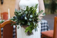 Greenery Bridal bouquet. Blue and green weddings. Fall wedding. Photographer:  Lori Blythe Photography Reception Venue: Chateau Polonez Floral Design: F. Dellit Designs Event Planner: Heather Benge Events Linens and Coverings: House of Hough Equipment Rentals: Aztec Events and Tents Paper Props: Blome's Paperie Calligrapher: Calligraphy Cult Hair Stylist: charmed by tonya Fashion Designer: Natalie Harris Design – Damsel White Label Cake Designer: Whisk Bakery