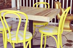 DIY Chair could repaint the chairs we have with neon paint and reupholster