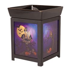 #Halloween #Scentsy Warmer:  House on A Haunted Hill.  Darling painted panels eerily illuminated by the lightbulb that also melts the wax in the tray on top, to safely scent your whole home!  Nothing scary about a Scentsy wickless candle!  Buy yours online at https://sattler.scentsy.us