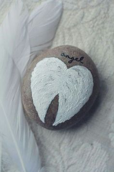 Rock painting of angel wings
