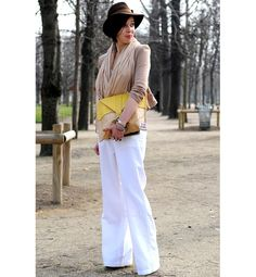 Sidewalk Style: Paris White Hot9 of 10  Wide-leg trousers are challenging the skinny jean to a duel. And while these white pants take center stage, a blond bag pops without overpowering the outfit.