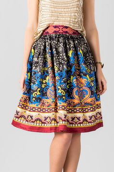 """Make a colorful statement when you wear the Bayliss Printed Midi Skirt! A vibrant print decorates this midi a-line skirt. Style with a tank & heels for a finished look.<br /> <br /> - 24"""" length from shoulder to hem<br /> - 24"""" waist<br /> - 72"""" sweep<br /> - measured from a size small<br /> <br /> - 100% Polyester<br /> - Hand or Machine Wash<br /> - Imported"""