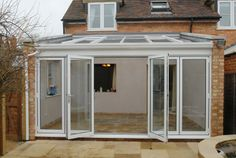 Crendon Conservatories designed, built and finished this lean-to style conservatory with parapet wall in Sydenham, Oxfordshire. Conservatory Dining Room, Lean To Conservatory, Conservatory Extension, Conservatory Design, Curved Pergola, Pergola Ideas, House Extension Design, Glass Extension, Facades