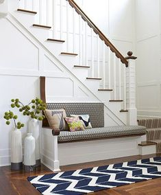 Stair bench, chevron rug, white and wood staircase, hard wood floors | Rachel Reider