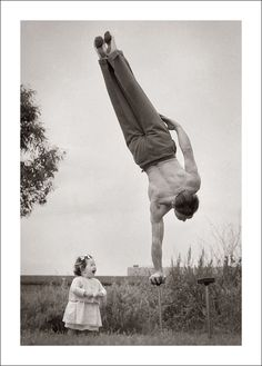 Dad showing off his skill to the surprise of little daughter in Melbourne, Australia, ca. 1940s