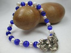 HOW CAN I DESCRIBE THIS BRACELET?  BLUE.  ELEGANT.  DELICATE.  DAINTY.  THOSE ARE JUST A FEW OF THE WORDS TO DESCRIBE THIS BLUE GEMSTONE, STRETCH BRACE.ET.  HANDMADE WITH B...