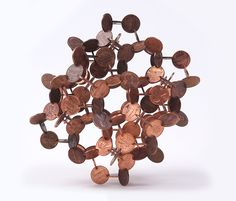 Geometric Coin Sculptures by Robert Wechsler sculpture multiples geometric currency