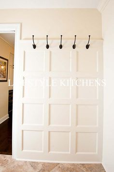 entry hooks on board and batten wall with a shelf above and a built in bench below. Use the same color as shown