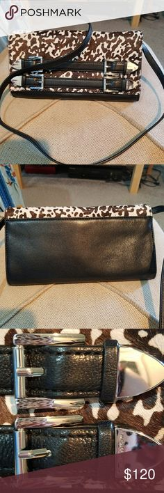 Michael Kors clutch/ shoulder bag price firm This clutch is featured in brown and beige calf - hair and leather with - stone hardware the buckle deitailing on the front give the bag extra glare while the multiple pocket provide interior organization it ferfec for a night out. Michael Kors Bags Clutches & Wristlets