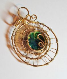 Small ceramic cabochon from Peruzi wire wrapped in brass by me!