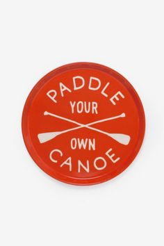 "Paddle Your Own Canoe Drink Tray! This bright orange tray with cream lettering is perfect for stepping up your entertaining game. Or it makes a great gift for your adventure loving friend. We love that it reminds us of the fiberglass lunch trays we used in middle school. But of coarse its way cooler.    Measures: 14""Dia by 3/4"" H   Canoe Drink Tray by Izola. Home & Gifts - Home Decor - Dining Montana"